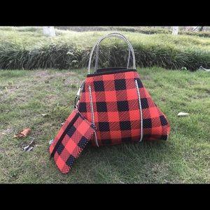 Large red blk bag. New. Has matching makeup bag